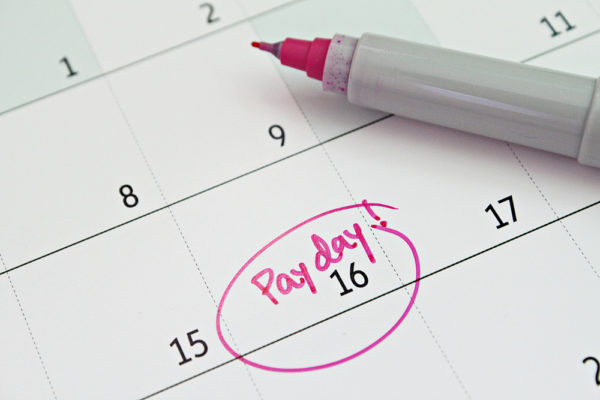 """""""Payday"""" written on a calendar and circled in red ink."""